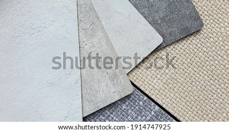 various texture and color of cement or concrete laminated samples isolated on beige and grey sackcloth fabric background with clipping path. interior material combination background for rustic mood. ストックフォト ©
