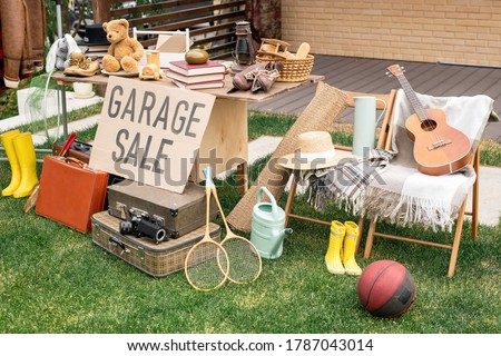 Various things placed on table and chairs in backyard, garage sale concept