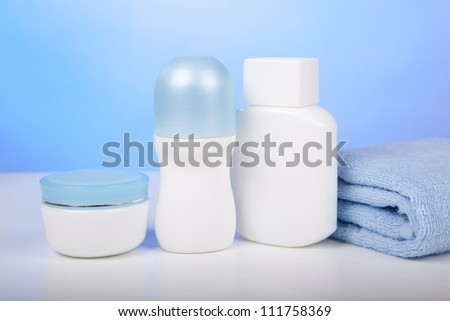 Various toiletries and cosmetics on a light background