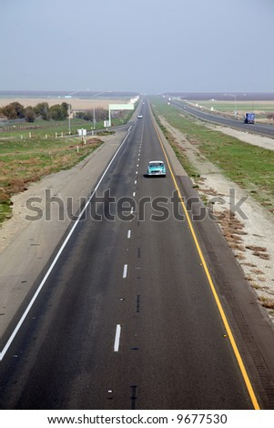 """Various Trucks and Cars cruise down """"Interstate 5"""" freeway in central california usa at a speed of """"70 mph"""""""