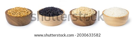Various type and color of rice ; paddy rice, riceberry, brown coarse rice and white thai jasmine rice in wooden bowl isolated on white background. Healthy diet concept.