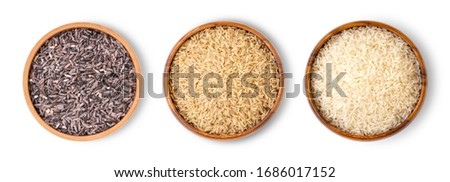 Various type and color of rice ;  riceberry ,brown coarse rice and white thai jasmine rice in wooden bowl isolated on white background. Healthy food concept. Flat lay. Top view.