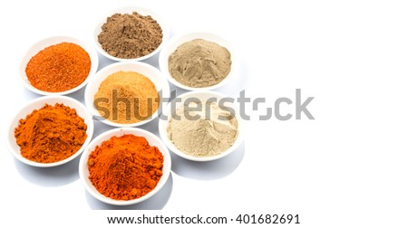 Various type of chili powder in white bowl over white background #401682691