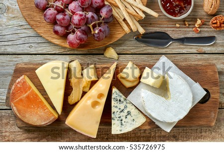 various types of cheese and fruits, top view