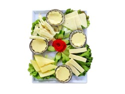 Various types of cheese on a white background