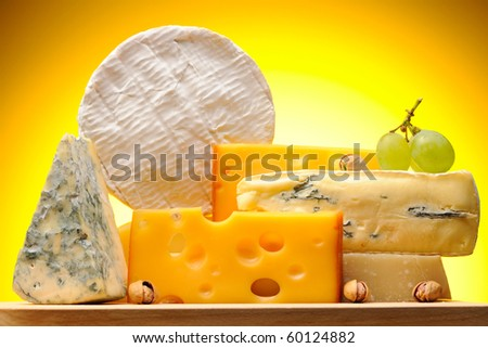 Various types of cheese on board - stock photo