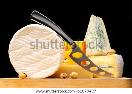 Various types of cheese over black
