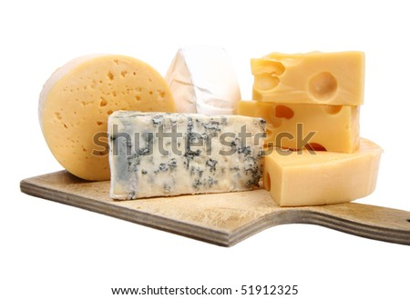 Various types of cheese (swiss, yellow, brie, blue cheese) isolated on white background