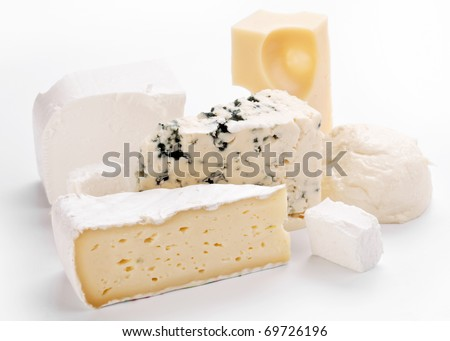 Various types of cheeses on a white background.