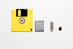 Various types of data storage. Flash drives, memory card and floppy disk