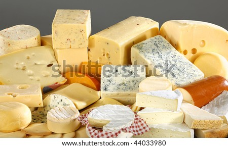 Various types of delicious cheese close up