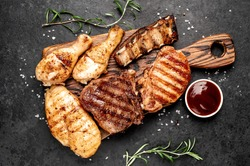 Various types of grilled meat, beef, pork, chicken on stone background