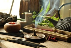 VARIOUS TYPES OF INCENSE WITH TEAPOT AND BUDDHA STATUE