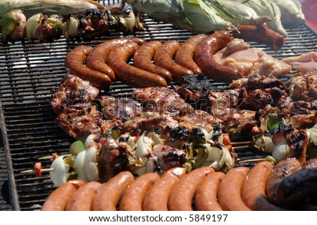 various types of meats being barbecued at an outdoor art show - stock photo