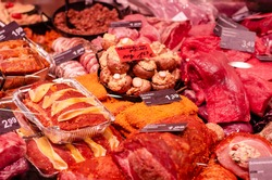 Various types of raw meat products for sale in the store