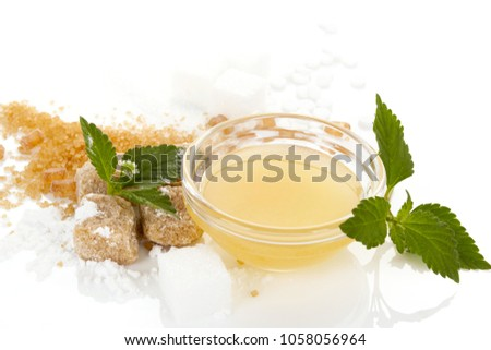 Various types of sweeteners -  brown, white, crystal sugar, artificial sweetener, cane and powdered sugar, honey in glass bowl. Isolated on white background.