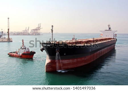 Various types of vessels calling at the port and moored at the berth. Tugs in the port. Jeddah Port, Saudi Arabia. December, 2018