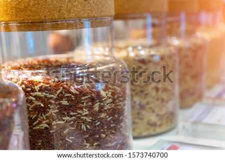 Various varieties of rice in the bottles for taking a specimen  with good quality control in laboratory.