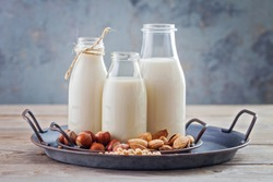 various vegan plant based milk and ingredients - food and drink