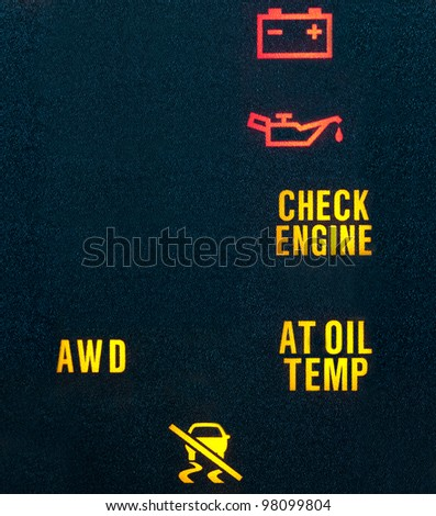 Various warning indicators showing battery, oil, check engine, transmission & traction control signs. Lots of copy space on left.