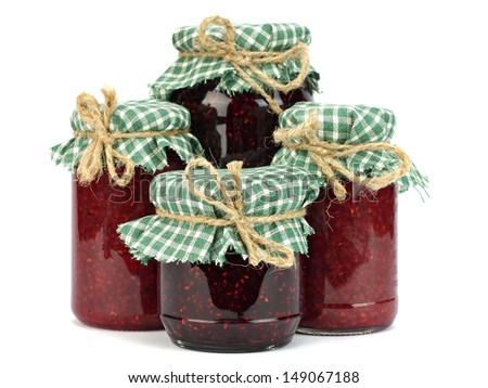 Various wild berries jam in glass jar on a white background
