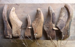 Various wooden shoe lasts in a row