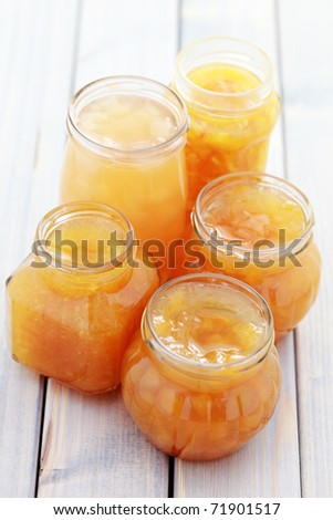 various yellow fruits jam in jars - food and drink