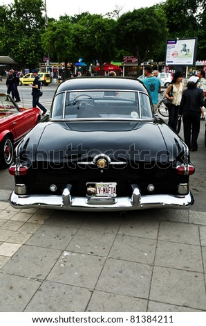 "VARNA, BULGARIA - JUNE 25: The annual Retro rally ""Old capitals"" finished for the first time in town of Varna on June 25, 2011 in Varna, Bulgaria. Packard branded car with Nevada state, US car plate. - stock photo"
