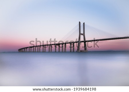 Vasco da Gama bridge at sunset. Lisbon bridge at sunset