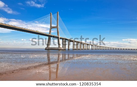Vasco da Gama bridge in Lisbon, Portugal. On Blue Sky