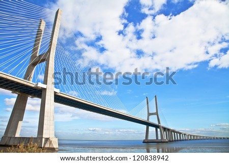 Vasco da Gama bridge in Lisbon, Portugal. On Blue Sky - stock photo