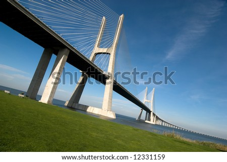 Vasco da Gama Bridge over the tagus river is the largest bridge in all Europe - stock photo