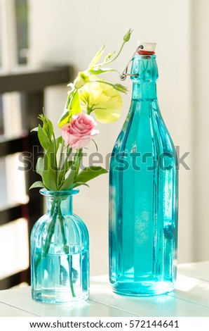 Vase and bottle made with blue glass. #572144641