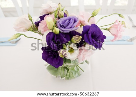 vase of flowers on tables