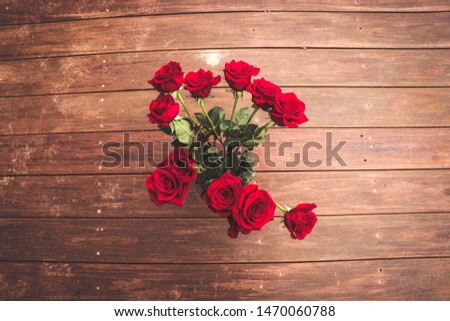 Vase of Red Red Red Roses