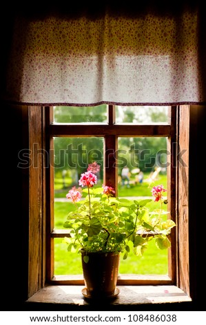 Vase with a flower on the windowsill country house.