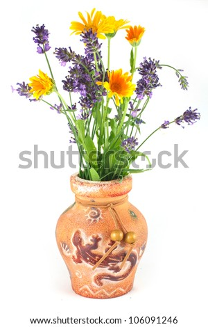 Vase with flowers of marigold and lavender isolated on a white background