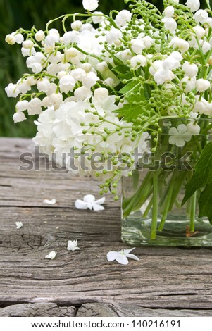 vase with lily of the valley and snowball/may/spring