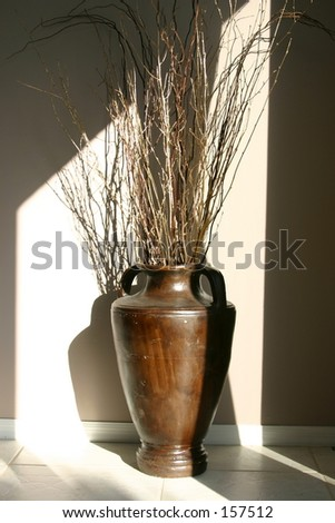 Vase with twigs and branches - stock photo