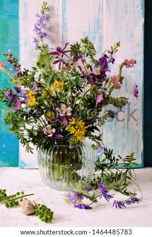 Vase with wildflowers in a glass vase #1464485783