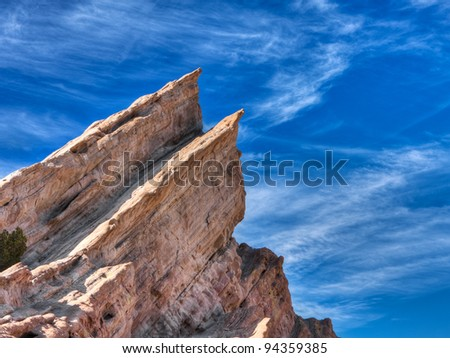 Vasquez Rocks located near Los Angeles California.  These rock formations have been used in many movies and commericals.  These geologic formations are a result of a fault line in the area.