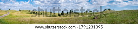Vast empty grassland with rolling hills depicting peace ストックフォト ©