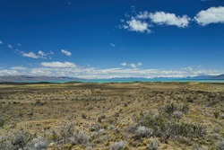 vast open landscape in Patagonia at turquoise Lago Viedma close to Fitz Roy mountain with snow covered mountains of the Andes in the background