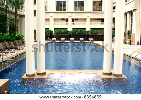 Vast swimming pool by high rise apartment with jacuzzi on one end stock photo 8356855 shutterstock for Houston swimming pool high rise