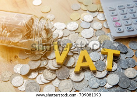 Vat Concept.Word vat put on coins and calculator on table.