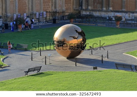 Vatican - August 18, 2015: People near modern installation Sphere within Sphere by Arnaldo Pomodoro in Belvedere Courtyard