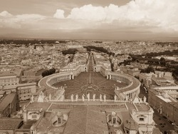 Vatican city and cityscape of Rome. Panoramic view from above. Famous St. Peters Square in the foreground, old town in the center and sky with stormy clouds in the background. Sepia tone photography.