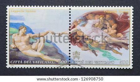 VATICAN CITY - CIRCA 1994: a postage stamp printed in Vatican City showing an scene of The Sistine Chapel frescoes in the Vatican by Michelangelo Buonarroti, circa 1994.
