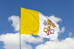 Vatican City flag isolated on sky background with clipping path. close up waving flag of Vatican City. flag symbols of Vatican.