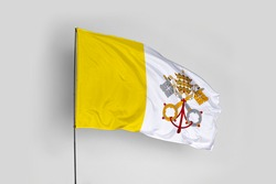 Vatican City flag isolated on white background with clipping path. close up waving flag of Vatican City. flag symbols of Vatican City.
